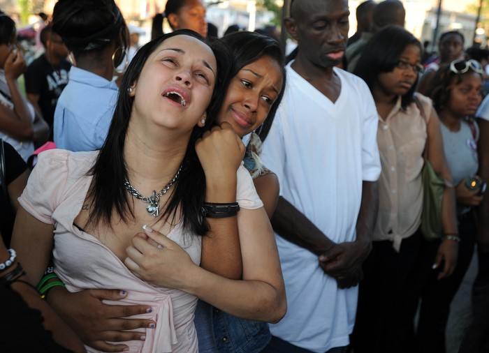 """3rd – Christopher Evans/Boston Herald – """"Painful Loss"""" - Emotions run raw as mourners weep at a vigil for a 15-year-old Roxbury teenager killed in a midday stabbing near Dudley Square in Boston on Wednesday, July 11, 2012."""