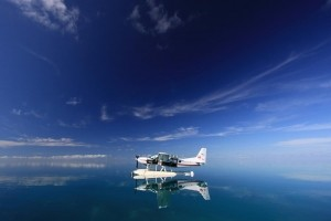 A Rare Reflection -  Photo and caption by Christian Roth/National Geographic Traveler Photo Contest -  Returning from a snorkeling excursion during a trip to the Great Barrier Reef, wind speed dropped to zero and the ocean became a mirror. As the horizon disappeared, only the seaplane, sitting confidently between the blue elements, provided a sense of space and felt like a link to the rest of the world.