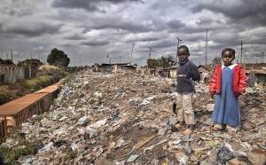Children of Kibera -  Photo and caption by Cynthia MacDonald/National Geographic Traveler Photo Contest -  Kibera is located just outside of Nairobi and is the largest slum in Africa with over a million people. It is built on piles and piles of garbage which is painfully obvious while walking the streets.