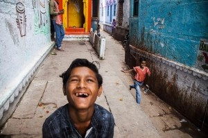 Explosion - Photo and caption by Stylianos Papardelas/National Geographic Traveler Photo Contest -  Children playing in the backstreets of old Varanasi. An explosion of colors, smiles and energy