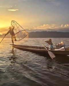 Fishing -  Photo and caption by Cynthia MacDonald/National Geographic Traveler Photo Contest -  A father and daughter with a fish in the net at sunset on Inle Lake, Myanmar.