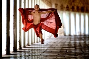 "Flying Monk -  Photo and caption by Bonnie Stewart /National Geographic Traveler Photo Contest -  Young monks begin their service very early in life in their studies in the monastery.  This monk was young and energetic and decided to ""fly"" in his exuberance for life."