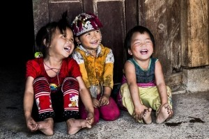 Happily Captured -  Photo and caption by Michael Siy/National Geographic Traveler Photo Contest -  Exploring Sa Pa village their way of living, their traditional colorful clothing, i was able to capture this three H'Mong kids playing outside their house.