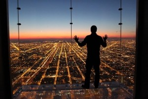 If Only I Could Fly -  Photo and caption by Gustavo Santos/National Geographic Traveler Photo Contest -  Spontaneous moment captured contemplating a beautiful and colorful sunset with all city lights down below.