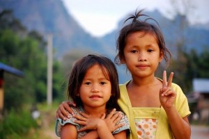 The Innocence of Love and Peace -  Photo and caption by Kim Hino/National Geographic Traveler Photo Contest -  The children in the remote villa of Kong Lo in Laos were simply beautiful in the innocence of their smiles and curiousity for these strangers among them, that after playing about in a pile of hay, they were even more comfortable in front of the camera and their true spirit in what I experienced in the simplicity that they enjoyed around them and shared with me came through. The symbolism in there chosen pose here speak volumes to me. to learn.