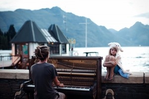 Merit: Piano play at sunset Photo and caption by Nikola Smernic/National Geographic Traveler Photo Contest Streets of Queenstown, New Zealand at the end of one more day filled with adrenaline. Calming and doleful scene with piano sound in the background.