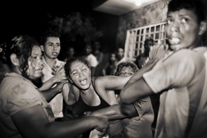 Photo and caption by Javier Arcenillas/National Geographic Photo Contest  Cries in the Sauce Colony of San Pedro Sula for a shot in the street. San Pedro  Sula is the most violent city of the world.