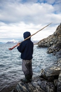 Photo and caption by Adam Coish /National Geographic Photo Contest  A local hunter of Pond Inlet grasps tightly onto a 5ft 6in tusk as he reflects on  his recent Narwhal Kill.