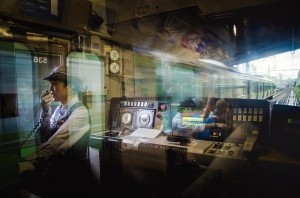 Photo and caption by Danilo Dungo/National Geographic Photo Contest  I was commuting in the train at Tokyo, when suddenly I notice this young girl  working as a conductor, announcing our next station stop at Shinagawa station.  The reflection in the glass inside the train and a slow shutter speed to blur the  moving background add to a creative moments to the photo including the light  ambient to the girl face find me interest to frame the scene that will last only for  a second.