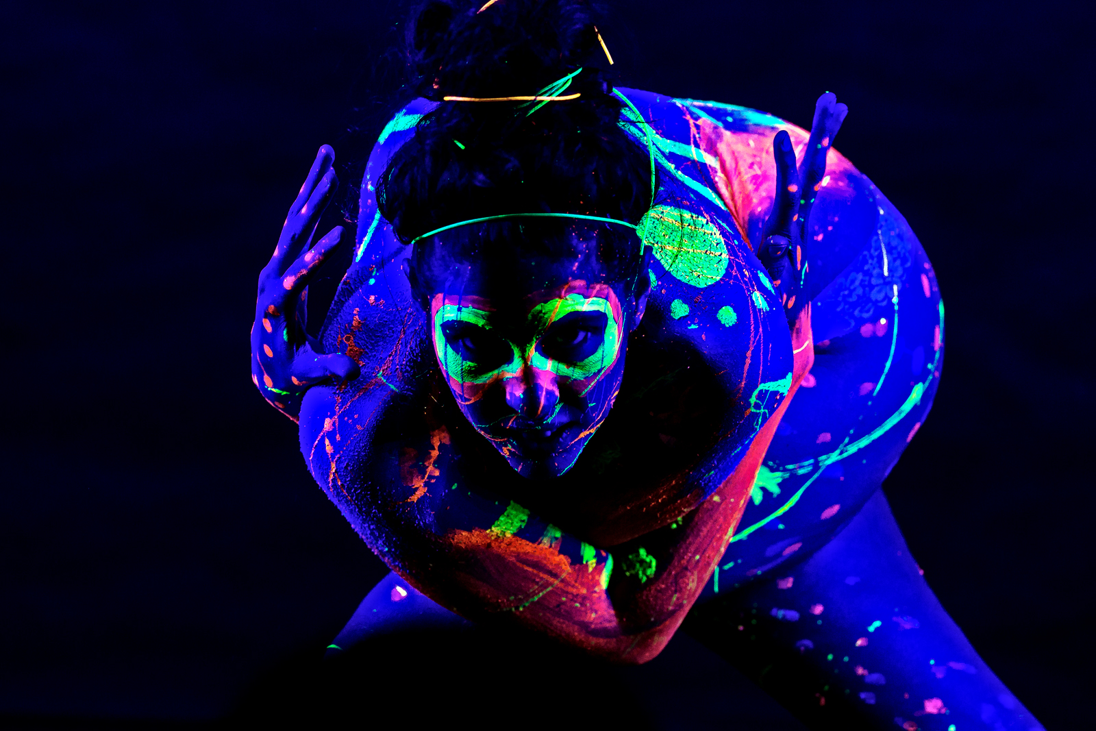 Aggression. Danni Wolf and the Black Light Body Paint. Photographers in Philadelphia. Philadelphia, PA